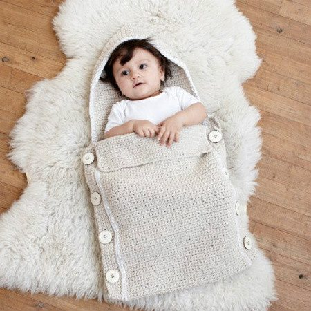 crochet baby sleeping bag Le Souk Crochet Supports Women in War Torn Countries