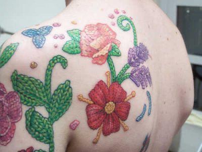 crochet flower tattoo 400x300 Hooked on Ink: 10 Cool Crochet Tattoos
