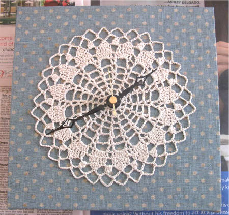 crocheted doily clock When A Doily Is Not Just a Doily: Curtains, Clocks, Necklaces and Other Upcycled Doily Ideas