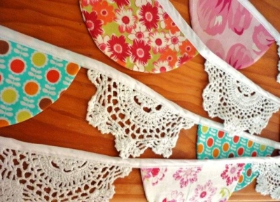 doily bunting1 400x289 When A Doily Is Not Just a Doily: Curtains, Clocks, Necklaces and Other Upcycled Doily Ideas