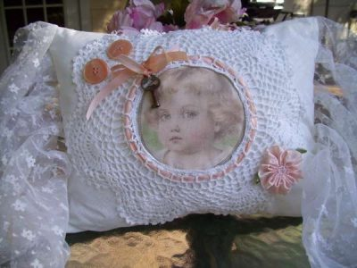 doily pillow 400x300 When A Doily Is Not Just a Doily: Curtains, Clocks, Necklaces and Other Upcycled Doily Ideas