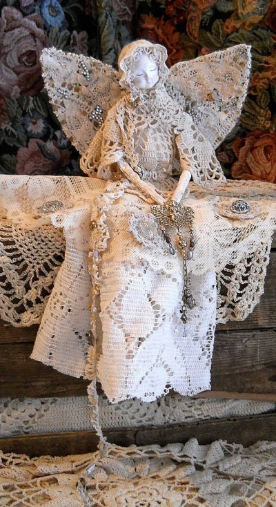 upcycled doily doll 400x734 12 Fascinating Examples of Crochet Art Dolls and Figures