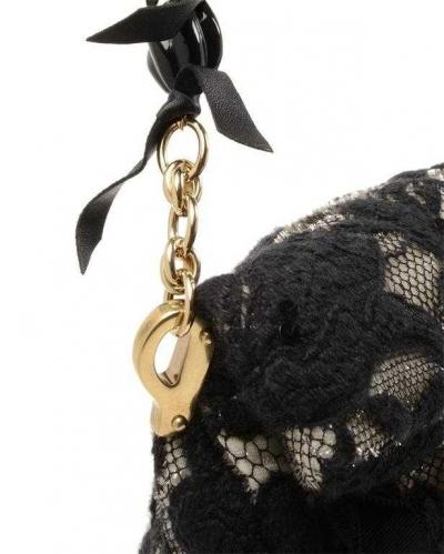 nina ricci crochet purse 400x499 Designer Crochet: Nina Ricci