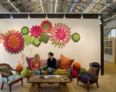 urban outfitters crochet wall1 400x318 Five Crafters Homes I Would Love To Have a Crochet Retreat At