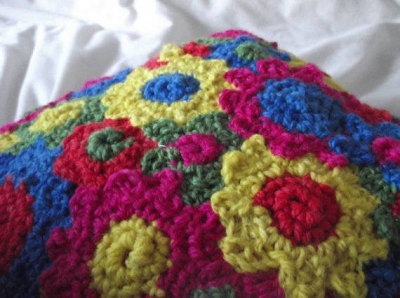 crochet flower cushion 400x298 Upcycling Knit and Crochet Artist Samantha Claire Wilson