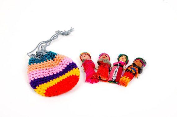 worry dolls in miniature crochet bag