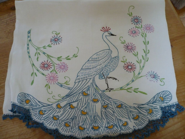 crochet peacock 600x450 20 Beautiful Examples of Crochet Mixed with Cross Stitch