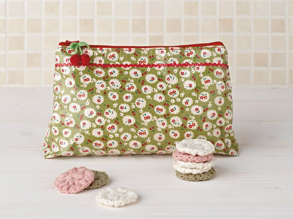 floral wash bag a crochet make-up remover pads on white wood and tiles