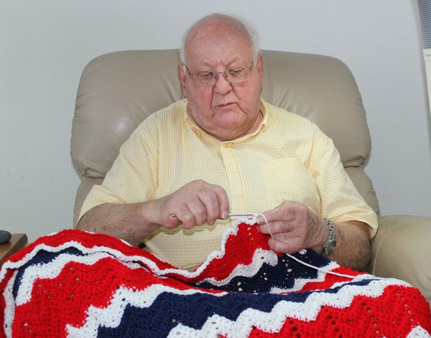 elderly male veteran crocheter