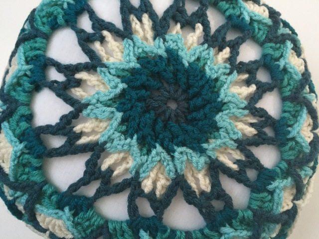 blue crochet mandala cushion