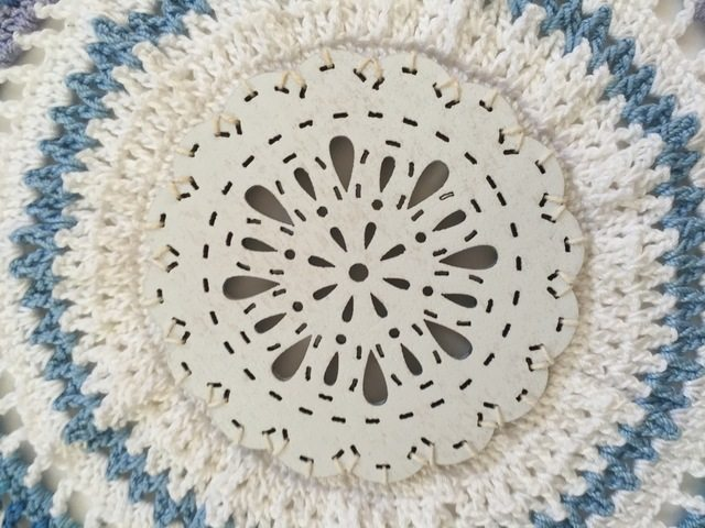 crochet mandala detail with wood by dianna