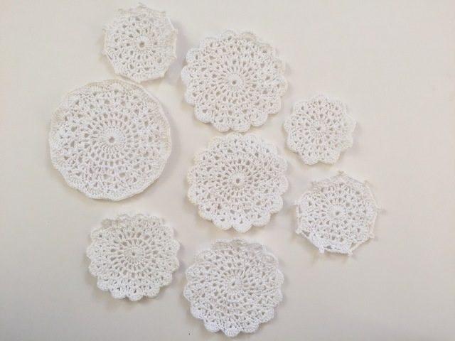 white crochet mandalas by dianna