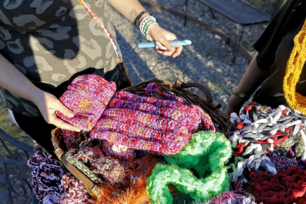 Stephanie Holloway shows off different crochet styles of purses she produced at the Mission Solano Bridge to Life Center, Thursday, Aug. 13, 2015, in Fairfield. The items including scarves, purses, and hats will be sold this weekend at the annual Tomato Festival. (Steve Reczkowski/Daily Republic)