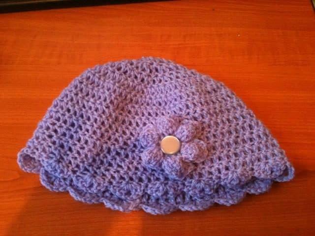 purple crochet hat by red squirrel crafts