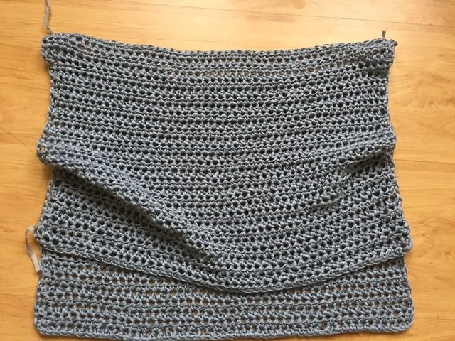 seaming together top of crochet dress
