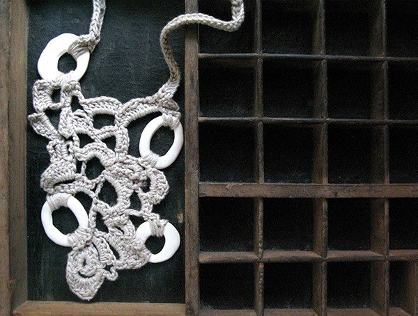 crochet art jewelry with organic shapes